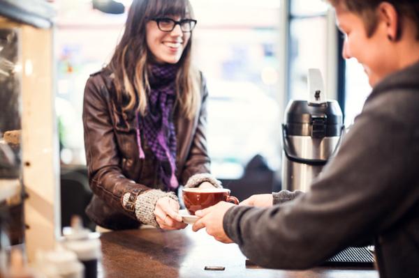 woman-buying-coffee-in-coffee-shop_u1t06e.jpg